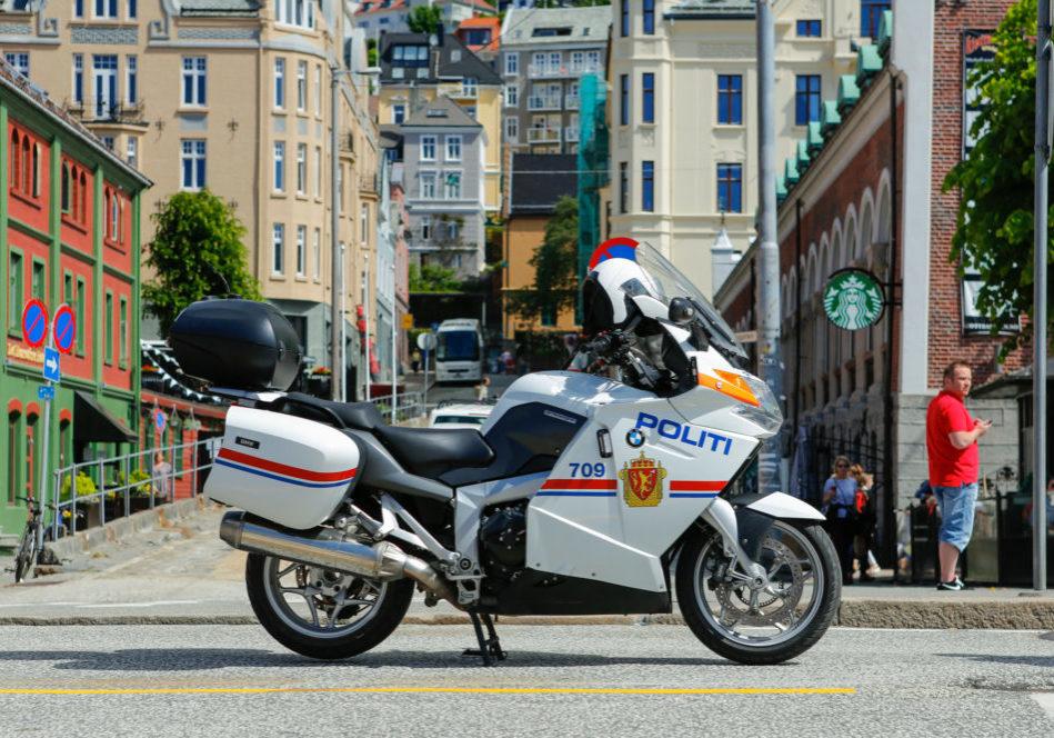 Bergen, Norway - June 12, 2016: Police motorcycle used as a road block at Hansa Days in Bergen, Norway.